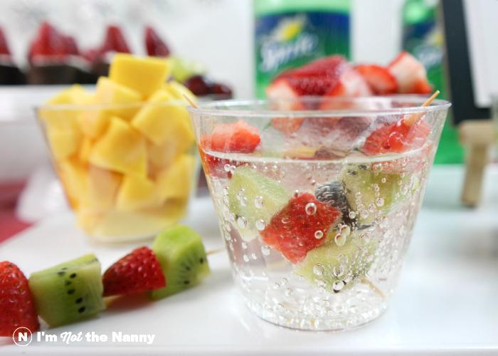 Sprite with fruit kabob garnish