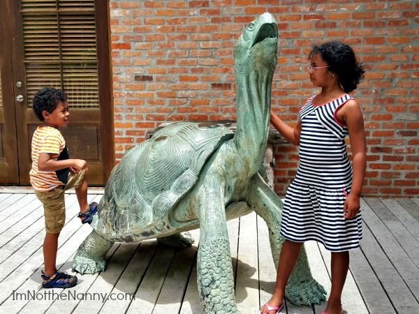 Kids with Turtle Statue via I'm Not the Nanny