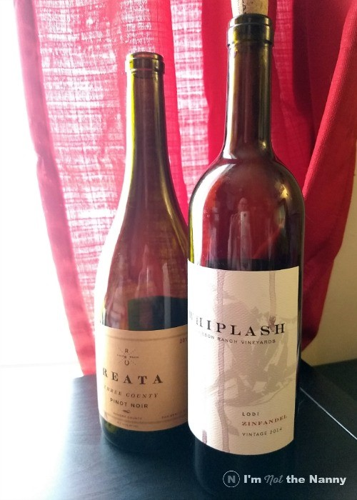 Two empty bottles of red wine